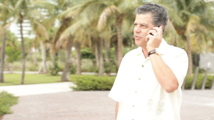 Cuban male talking on a cellphone