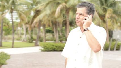 Cuban male talking on a cellphone