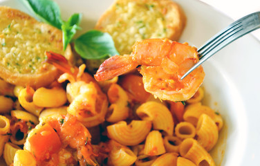 a delicious macaroni & shrimp  , shrimp on fork