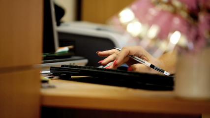 woman's hand on the keyboard