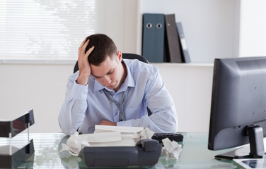 Businessman frustrated by paperwork
