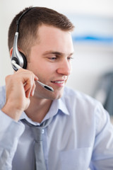 Close up of call center agent solving a costumers problem