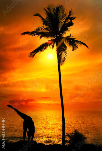 Yoga silhouette at ocean