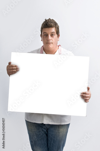 a  man in studio hold a white table