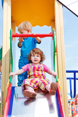 Toddlers on a chute