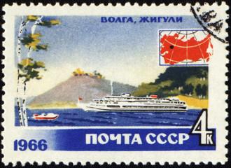 Passenger ship at Volga river on post stamp