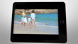 tablet displaying videos about family having fun