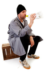 male homeless tramp with empty bottle over white background