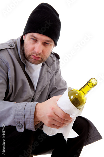 male homeless tramp with empty bottle