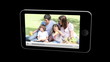 Smartphone showing families relaxing
