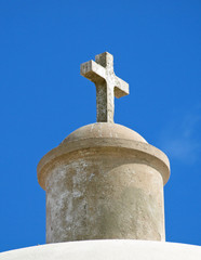 Stone cross on the top of an old church