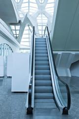 fast moving escalator inside shopping mall