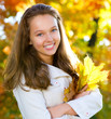 Beautiful Teenage Girl in Autumn Park