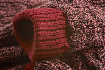 Macro  photograph of red knitted sock