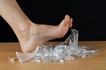 Foot and broken glass