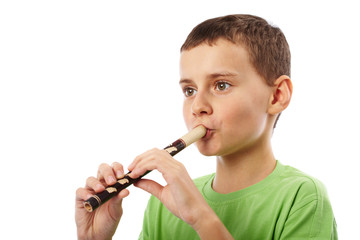 Boy playing the pipe