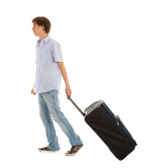 casual young man with suitcase, full length