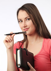 Young woman holding a filofax
