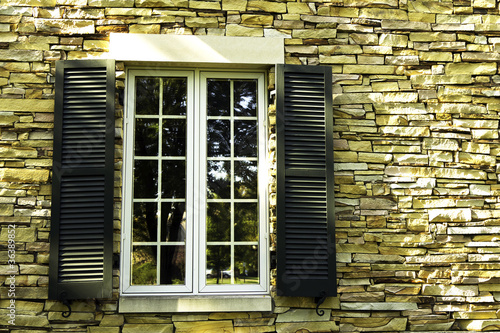 Window in a stone wall with shutters