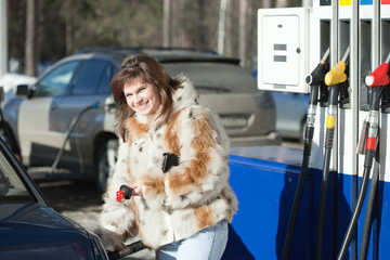 woman filling her car