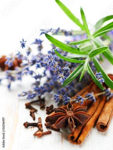 Assorted spices, rosemary and lavender flowers