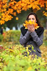 Girl in park colourful autumn