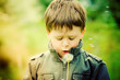 Child Blowing Dandelion