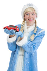 girl in christmas costume of Snow Maiden gifts automobile
