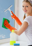 young woman washing windows