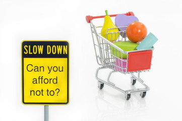 Slow down traffic sign and shopping cart