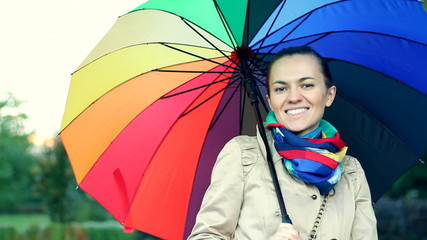 Woman walking with colorful umbrella