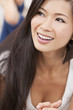 Beautiful Chinese Oriental Asian Woman Relaxing & Smiling