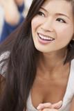 Beautiful Chinese Oriental Asian Woman Relaxing & Smiling