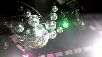 Mirror balls are in the nightclub at the disco