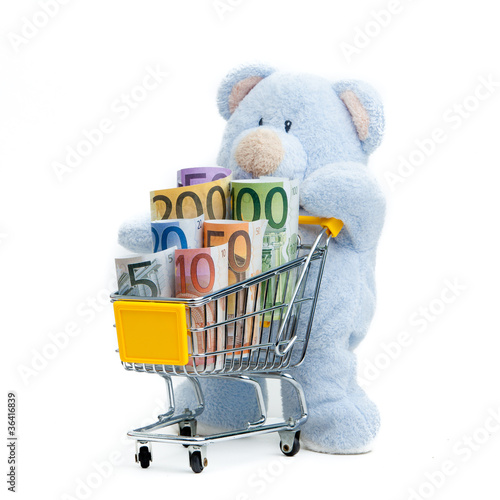 shopping cart with euro banknotes on white