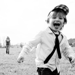 boy running meadow