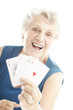 senior woman playing poker