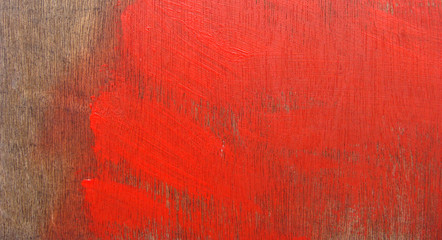 bright red paint stroke on timber wood panel
