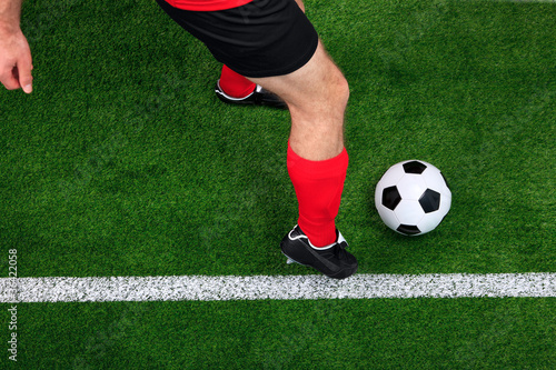 Overhead football player dribbling