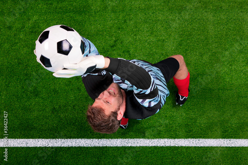 Overhead shot of a goalkeeper saving the ball in the air.