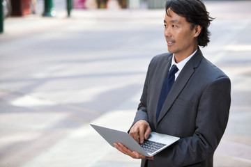 Business Man with Laptop Outdoors