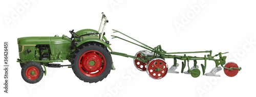 nostalgic toy tractor with plowshare
