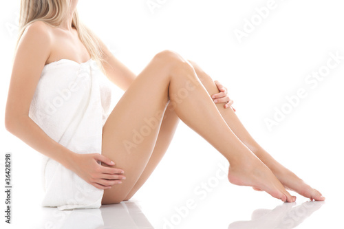 Beautiful female sitting on the floor in towel