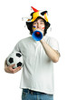 Football fan with ball and trumpet