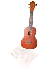 Ukelele with sheet music