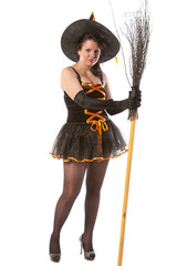 sexy girl in Halloween witch with broom