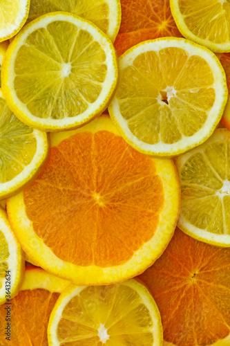Fotobehang Plakjes fruit Orangen- und Zitronenscheiben