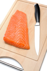 fresh raw salmon fish on wooden board isolated. sushi ingredient