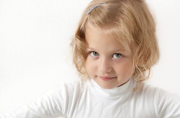 Blonde little girl  dressed in white