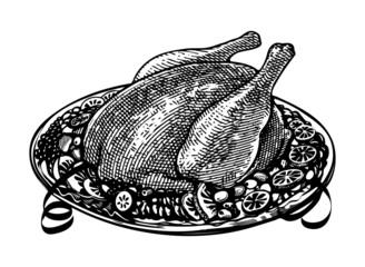 whole roasted turkey on  decorated platter with garnish